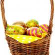 Cane basket with easter eggs in closeup — Stock Photo