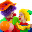 Two children dressed as colorful funny clown with balloons — Stock Photo
