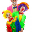 Royalty-Free Stock Photo: Three dressed up as colorful funny clowns