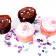 Four delicious cupcakes and colorful confetti — Stock Photo #9703349