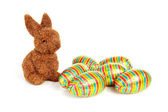 Easter bunny and colorful eggs — Stock Photo