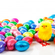 Colorful easter eggs and yellow chicken — Stock Photo