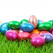 Stock Photo: Colorful chocolate easter eggs on grass