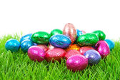 Colorful chocolate easter eggs on grass — Stock Photo