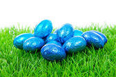 Blue chocolate easter eggs on grass — Stock Photo