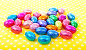 Colorful easter eggs on yellow dotted napkin — Stock Photo