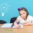 Стоковое фото: Young and happy girl doing her school work