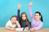 Three happy girls doing their school work — Foto Stock