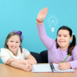 Two girls doing their school work in classroom — Stock Photo