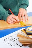 Real carpenter taking measurements — Stock Photo