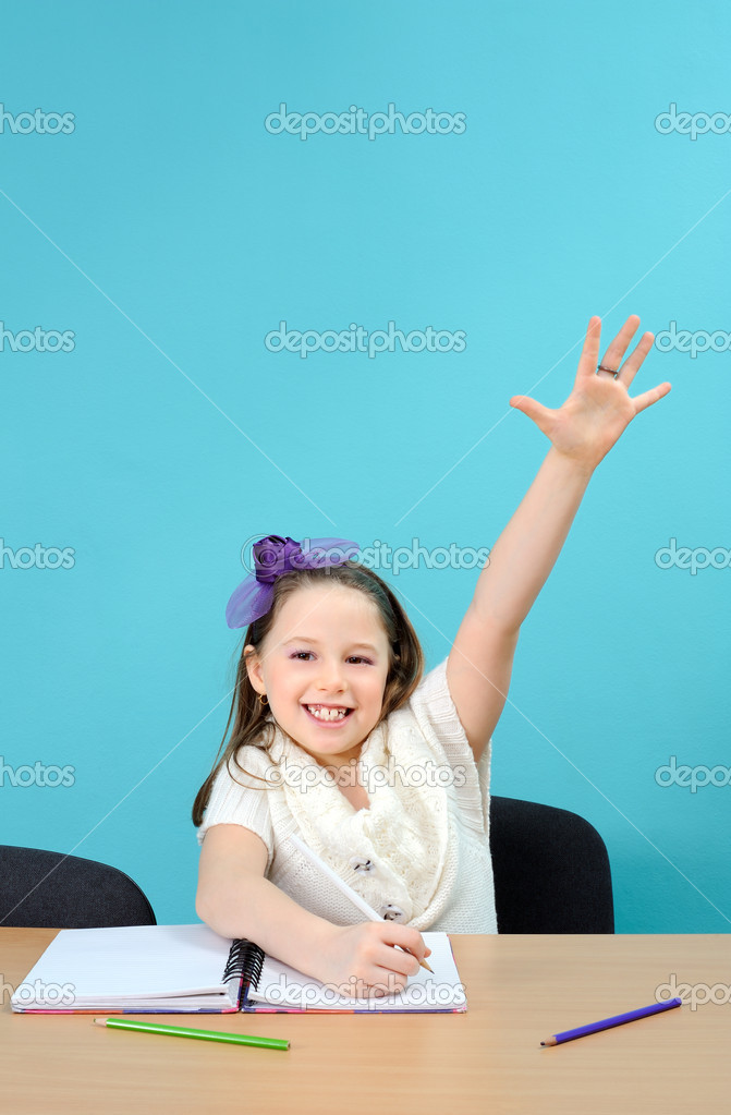 Young and happy schoolgirl doing her school work — Stock Photo #8493136