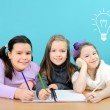 Happy school girls doing their work in classroom — Stock Photo