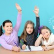 Three happy girls doing their school work — Stock Photo #8664844