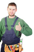 Real handsome carpenter showing thumb up — Stock Photo