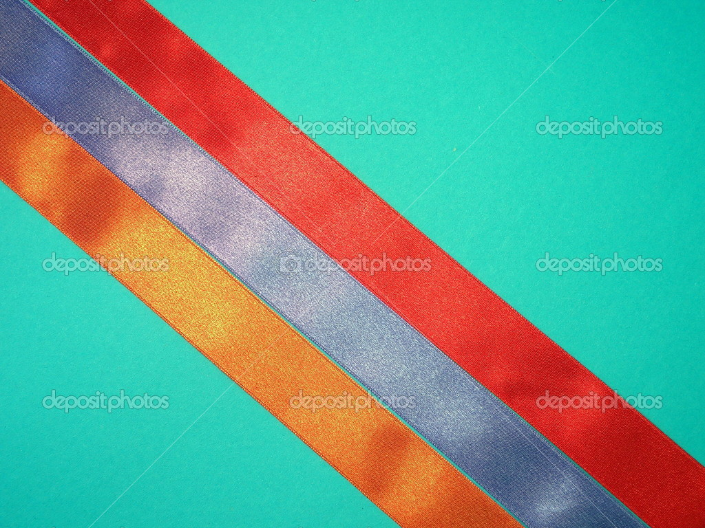Colorful satin ribbons on blue background — Stock Photo #10316707