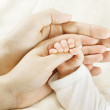 Family, baby hand inside parents hands — Stock Photo