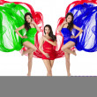 Three woman dance in red, green, blue flying dress — Stock Photo