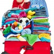 Travel suitcase packed for vacation in seresort — Stock Photo #9249749