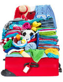 Travel suitcase packed for vacation in sea resort — Stock Photo