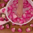 Spa Treatment with aromatic roses, petals, and candle — Stock Photo