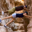 Two teenage hikers taking a break and having fun inside a canyon in Nevada - Foto de Stock