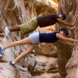 Two teenage hikers taking a break and having fun inside a canyon in Nevada - Stok fotoğraf
