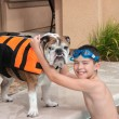 Child and His Pet Dog - Stockfoto