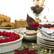 Elegant table with many desserts and fruit — Stock Photo