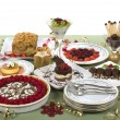 Elegant table with many desserts and fruit - Stock Photo