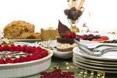 Elegant table with many desserts and fruit — Stockfoto