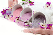 Bath salt crystals and orchids in a spa — Stock Photo