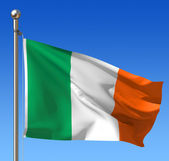 Flag of Ireland against blue sky — Stock fotografie