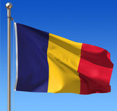 Flag of Chad against blue sky. — Stock Photo