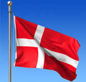 Flag of Denmark against blue sky. — Stock Photo