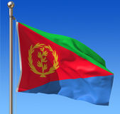Flag of Eritrea against blue sky. — Stock Photo