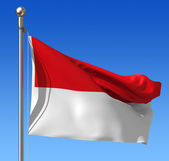 Flag of Indonesia against blue sky. — Stock Photo