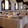 Laid tables with red wine in restaurant — Foto de Stock
