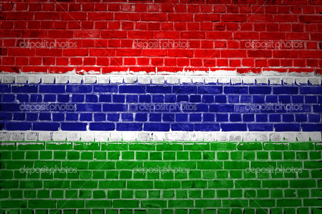 An image of the Gambia flag painted on a brick wall in an urban location — Stock Photo #8867005