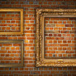 Royalty-Free Stock Photo: Golden frames on brick wall