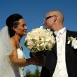 Stock Photo: Wedding bouquet and wedding couple