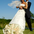 Bouquet and wedding couple — Stock Photo #8514357