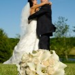 Wedding bouquet and couple — Stock Photo #8733533