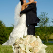 Stock Photo: Wedding bouquet and couple