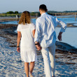 Young couple walking on beach — Stock Photo #9204932