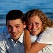 Happy young couple at beach — Stock Photo #9205035