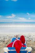 Santa claus on vacation — Stock Photo