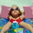 Child in pool relaxing — Stock Photo
