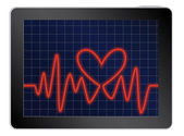 Cardiogram with heart on a tablet — Stock Vector