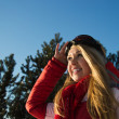 Woman in winter sport wear looking at the horizon — Stock Photo