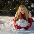 Woman building a snow pile — Stock Photo #8869208